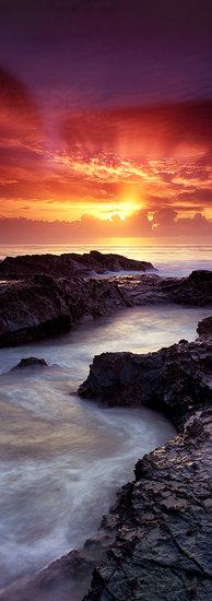 Stunning vertical panoramic of sunrise over Currumbin Rocks Gold Coast