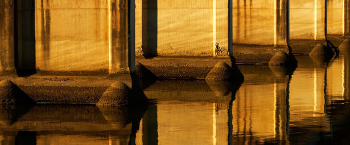 Historic old bridge in golden sunrise light